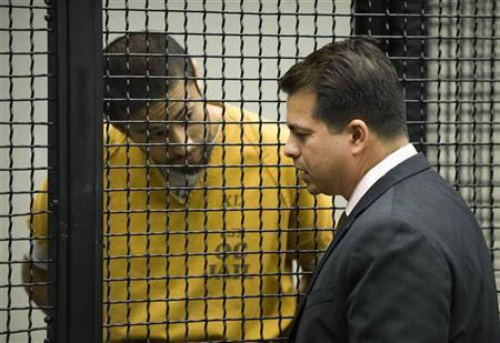 Former U.S. Marine Itzcoatl Ocampo, an Iraq war veteran, speaks with his defense attorney Randall Longwith during his arraignment on charges of four counts of first degree murder in Santa Ana, California February 6, 2012. REUTERS/Bruce Chambers/Pool