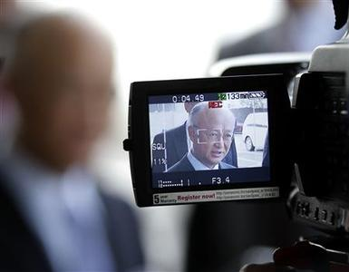 International Atomic Energy Agency (IAEA) Director General Yukiya Amano is seen through a video camera screen as he briefs the media before his trip to Tehran at the international airport in Vienna May 20, 2012. REUTERS/Leonhard Foeger