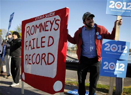 Supporters of President Barack Obama demonstrate before a campaign stop by Republican presidential candidate and former Massachusetts Governor Mitt Romney at the fish pier in Portsmouth, New Hampshire, April 30, 2012. REUTERS/Brian Snyder