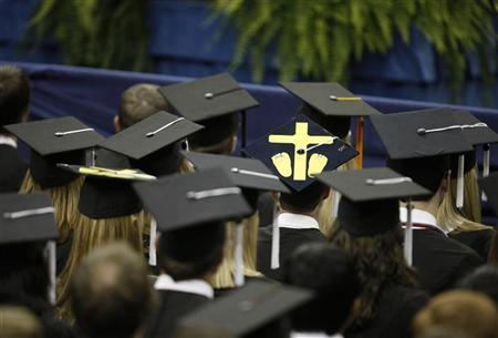 A student wears a mortorboard with a symbol for an aborted fetus, during a commencement address by U.S. President Barack Obama at the University of Notre Dame in South Bend, Indiana, May 17, 2009. REUTERS/John Gress