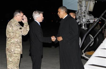 U.S. President Barack Obama shakes hands with U.S. Ambassador to Afghanistan Ryan Crocker upon his arrival at Bagram Air Base in Kabul, Afghanistan May 1, 2012. REUTERS/Kevin Lamarque