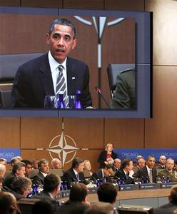 U.S. President Barack Obama (lower right) is seen speaking on a video screen at the opening of the Afghanistan meeting at the 2012 NATO Summit in Chicago, May 21, 2012. REUTERS/Larry Downing
