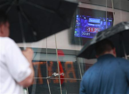Monitors show the value of the Facebook, Inc. stock during morning trading at the NASDAQ Marketsite in New York, May 21, 2012. REUTERS/Brendan McDermid