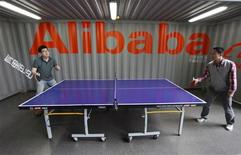 Employees play table tennis inside the headquarters office of Alibaba (China) Technology Co. Ltd on the outskirts of Hangzhou, Zhejiang province May 21, 2012. REUTERS/Steven Shi