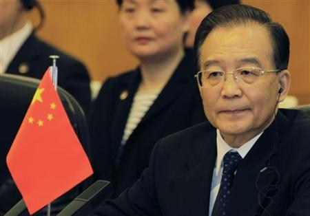 China's Premier Wen Jiabao attends a meeting of the fifth trilateral summit among China, South Korea and Japan at the Great Hall of the People in Beijing, May 13, 2012. REUTERS/Petar Kujundzic