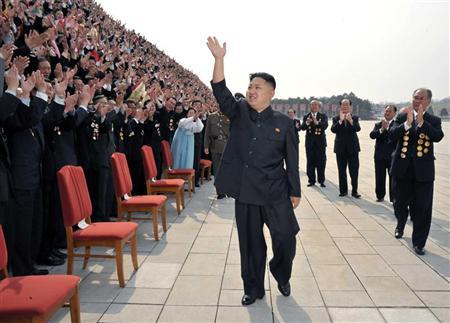 North Korean leader Kim Jong-Un (C) waves as he arrives to take pictures with officials, creators and employees of the Mansudae Art Studio in Pyongyang April 19, 2012 in this picture released by the North's KCNA on Thursday. REUTERS/KCNA