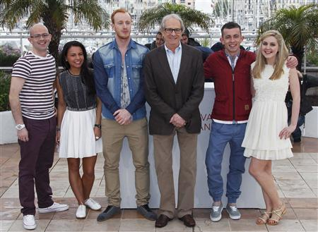 Director Ken Loach (3rd,R) poses with cast members (LtoR) Gary Maitland, Jasmin Riggins, William Ruane, Paul Brannigan and Siobhan Reilly during a photocall for the film ''The Angel's Share'', in competition at the 65th Cannes Film Festival, May 22, 2012. REUTERS/Vincent Kessler