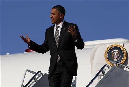U.S. President Barack Obama gestures upon arriving at Joplin Regional Airport aboard Air Force One in Missouri May 21, 2012. REUTERS/Larry Downing