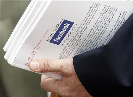 An investor holds prospectus explaining the Facebook stock after attending a show for Facebook Inc's initial public offering in Boston, Massachusetts, in this May 8, 2012 file photo. REUTERS/Jessica Rinaldi/Files