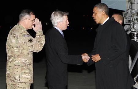 U.S. President Barack Obama shakes hands with U.S. Ambassador to Afghanistan Ryan Crocker upon his arrival at Bagram Air Base in Kabul, Afghanistan May 1, 2012. REUTERS/Kevin Lamarque