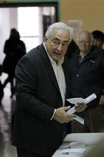 Former IMF head Dominique Strauss-Kahn leaves arrives to vote at a polling station in the second round of the 2012 French presidential elections in Sarcelles May 6, 2012. Voting started in mainland France on Sunday in the runoff presidential elections. REUTERS/Gonzalo Fuentes