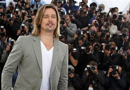 Cast member Brad Pitt attends a photocall for the film ''Killing Them Softly'', by director Andrew Dominik, in competition at the 65th Cannes Film Festival, May 22, 2012. REUTERS/Yves Herman