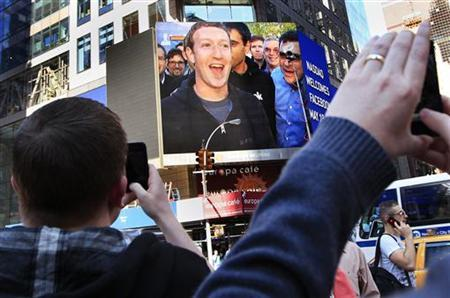 Facebook Inc. CEO Mark Zuckerberg is seen on a screen televised from their headquarters in Menlo Park moments after their IPO launch in New York May 18, 2012. REUTERS/Shannon Stapleton