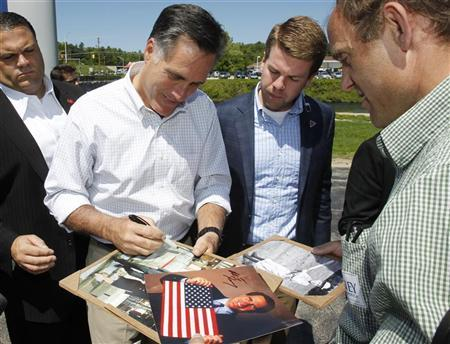 Republican presidential candidate and former Massachusetts Governor Mitt Romney signs autographs for supporters during a campaign event in Hillsborough, New Hampshire May 18, 2012. REUTERS/Jessica Rinaldi