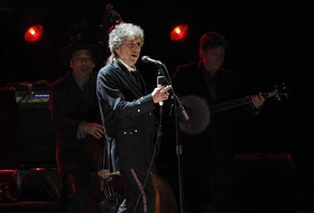 Bob Dylan performs during a segment honoring Director Martin Scorsese, recipient of the Music + Film Award, at the 17th Annual Critics' Choice Movie Awards in Los Angeles January 12, 2012. REUTERS/Mario Anzuoni