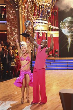 In this publicity photograph released by ABC May 22, 2012, Donald Driver and Peta Murgatroyd hold the mirror ball trophy after the pair won as ''Dancing with the Stars'' champions during the finals show telecast May 22, 2012. REUTERS/Adam Taylor/ABC/© 2012