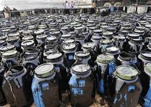 Containers filled with oil cleaned up from the oil spill site are seen at Beilianggang port in Dalian, Liaoning province July 24, 2010. REUTERS/Stringer