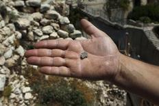 A clay seal recently unearthed by Israeli archaeologists is displayed by Eli Shukron, who directed the excavation on behalf of the Israel Antiquities Authority, just outside Jerusalem's Old City May 23, 2012. REUTERS/Baz Ratner