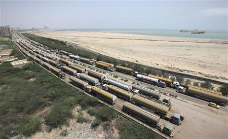 Fuel tankers, which were used to carry fuel for NATO forces in Afghanistan, are parked along a roadside near Karachi's Clifton Beach May 23, 2012. REUTERS/Akhtar Soomro