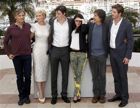 Director Walter Salles (2ndR) and cast members (LtoR) Viggo Mortensen, Kirsten Dunst, Sam Riley, Kristen Stewart and Garret Hedlund pose during a photocall for the film ''On The Road'', in competition at the 65th Cannes Film Festival, May 23, 2012. REUTERS/Eric Gaillard