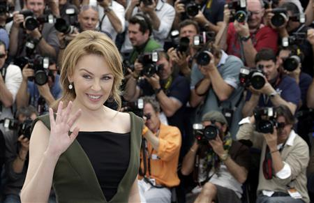 Cast member Kylie Minogue poses during a photocall for the film ''Holy Motors'', in competition at the 65th Cannes Film Festival, May 23, 2012. REUTERS/Eric Gaillard