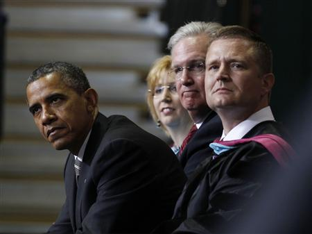 U.S. President Barack Obama leans forward from his seat to look at graduates as the choir sings at the 2012 Joplin High School commencement ceremony inside the Leggett and Plant Athletic Center at Missouri Southern State University in Joplin, Missouri, May 21, 2012. REUTERS/Larry Downing