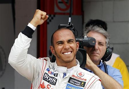 McLaren Formula One driver Lewis Hamilton of Britain celebrates after taking the pole position in the qualifying session of the Spanish F1 Grand Prix at the Circuit de Catalunya in Montmelo, near Barcelona, May 12, 2012. REUTERS/Albert Gea