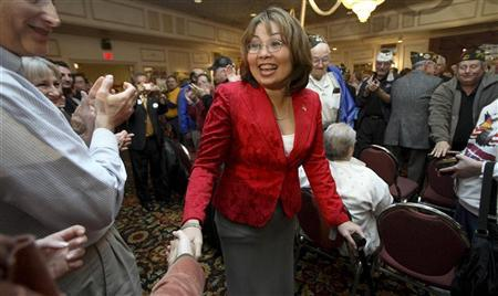 A 2006 file photo shows Tammy Duckworth as she campaigns for congress in Elmhurst, Illinois. REUTERS/John Gress