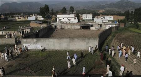 Residents surround the compound where al Qaeda leader Osama bin Laden was killed in this ariel view in Abbottabad May 4, 2011. REUTERS/Faisal Mahmood