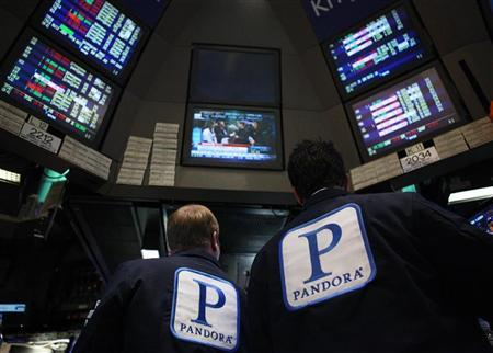 Traders work at the kiosk where Pandora internet radio is traded on the floor of the New York Stock Exchange. REUTERS/Brendan McDermid