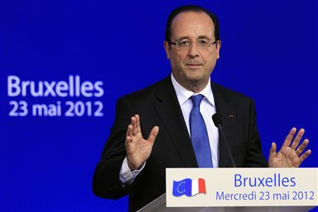 French President Francois Hollande briefs the media after an informal European Union leaders summit in Brussels May 24, 2012. EU leaders discussed ways to revive their economies on Wednesday night, with growth and jobs on the agenda along with the situation in Greece. REUTERS/Pascal Rossignol