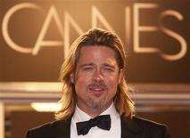"Cast member Brad Pitt poses on the red carpet after the screening of the film ""Killing Them Softly"", in competition at the 65th Cannes Film Festival, May 22, 2012. REUTERS/Christian Hartmann"