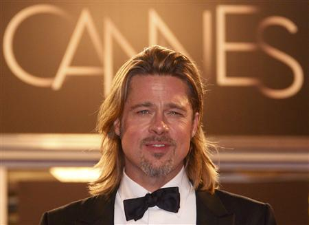 Cast member Brad Pitt poses on the red carpet after the screening of the film ''Killing Them Softly'', in competition at the 65th Cannes Film Festival, May 22, 2012. REUTERS/Christian Hartmann