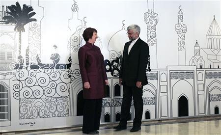 European Union foreign policy chief Catherine Ashton (L) chats with Iran's chief negotiator Saeed Jalili as they pose for the media before their meeting in Baghdad May 23, 2012. REUTERS/Thaier al-Sudani