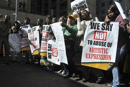 Members of the ruling African National Congress (ANC) demonstrate against the showing of a painting by artist Brett Murray, outside a court in Johannesburg May 22, 2012. REUTERS/Ihsaan Haffejee