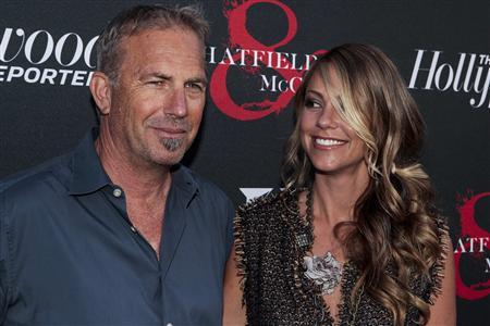 Actor Kevin Costner and his wife Christine Costner arrive for the premiere of television series ''Hatfields and McCoys'' at Milk Studios in Los Angeles, California, May 21, 2012. REUTERS/Bret Hartman