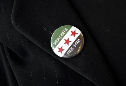 A supporter of the opposition Syrian National Council, wears a pin that reads ''Free Syria'' as she waits for the head of the opposition Syrian National Council Burhan Ghalioun to arrive in Rome May 12, 2012. REUTERS/Alessandro Bianchi