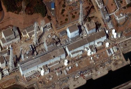 (From R to L) Reactors No. 1 to 4 are seen at the Fukushima Daiichi Power Plant in Fukushima is seen in this satellite image, taken and released by DigitalGlobe March 18, 2011. REUTERS/DigitalGlobe/Handout/Files