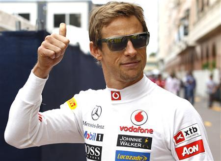 McLaren Formula One driver Jenson Button of Britain gives the thumb up before the start of the second practice session of the Monaco F1 Grand Prix May 24, 2012. REUTERS/Max Rossi