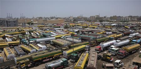 Fuel tankers, which were used to carry fuel for NATO forces in Afghanistan, are parked at a compound in Karachi May 23, 2012. REUTERS/Akhtar Soomro
