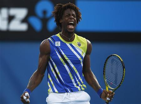 Gael Monfils of France reacts during his men's singles match against Mikhail Kukushkin of Kazakhstan at the Australian Open tennis tournament in Melbourne January 21, 2012. REUTERS/Daniel Munoz