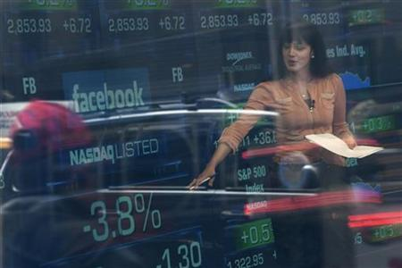 A television reporter talks about the Facebook stock at the NASDAQ MarketSite in New York's Times Square May 22, 2012. REUTERS/Keith Bedford