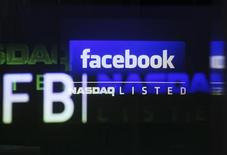 The Facebook logo is seen on a screen inside at the Nasdaq Marketsite in New York in this May 18, 2012, file photo. REUTERS/Shannon Stapleton/Files