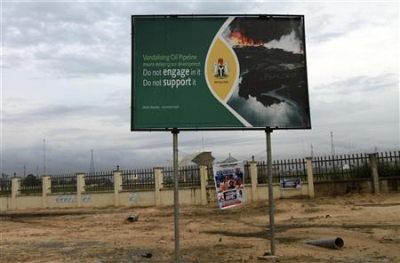 A signboard campaigning against oil pipeline vandalism is seen along a road in Yenagoa in Nigeria's Bayelsa state May 15, 2012. Picture taken May 15, 2012. REUTERS/Akintunde Akinleye