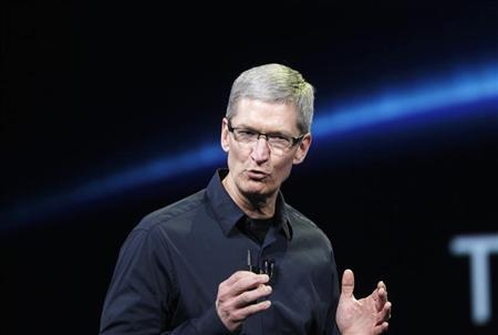 Apple CEO Tim Cook speaks on stage during an Apple event introducing the new iPad in San Francisco, California in this March 7, 2012 file photo. REUTERS/Robert Galbraith