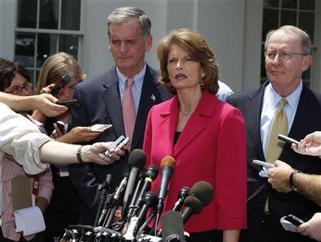 Sen. Lamar Alexander (R), Sen. Lisa Murkowski (2nd R), and Sen. Judd Gregg (3rd R) talk after meeting with President Barack Obama and a bipartisan group of Senators to discuss passing comprehensive energy and climate legislation in Washington, June 29, 2010. REUTERS/Larry Downing