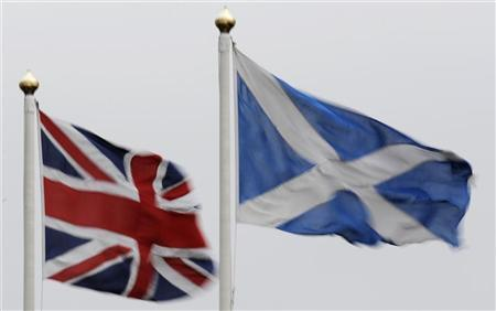 The Union flag and Saltire are seen flying side by side at Bankfoot in Perthshire, Scotland January 10, 2012. British Prime Minister David Cameron said Scotland should hold an independence referendum as early as next year, clashing with the Scottish National Party (SNP) which wants more time to rally support for a break from the United Kingdom. Cameron, who opposes Scottish independence, said uncertainty about the 300-year-old union between England and its smaller northern neighbour was creating problems for business and harming investment. REUTERS/Russell Cheyne