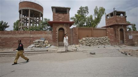 A policeman walks past Central Jail in Peshawar May 24, 2012. Pakistani authorities have sentenced the doctor accused of helping the CIA find Osama bin Laden to 33 years in jail on charges of treason, officials said, a move that drew angry condemnation from U.S. officials already at odds with Islamabad. Shakil Afridi, who is currently in Central Jail, was accused of running a fake vaccination campaign, in which he collected DNA samples, that is believed to have helped the American intelligence agency track down bin Laden in a Pakistani town. REUTERS/Fayaz Aziz