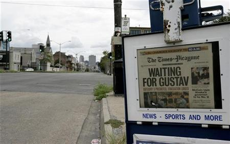 A copy of The Times-Picayune is displayed on a deserted downtown street after the evacuation of New Orleans, prior to the arrival of Hurricane Gustav, August 31, 2008. REUTERS/ Mark Wallheiser