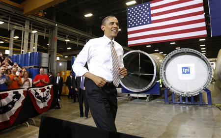U.S. President Barack Obama takes the stage to speak about energy during a visit to TPI Composites, a wind energy manufacturer, in Newton, Iowa May 24, 2012. REUTERS/Kevin Lamarque